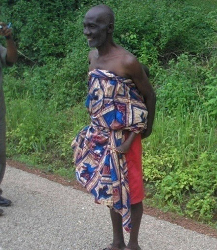 Agya Yaw carrying his granddaughter on his back