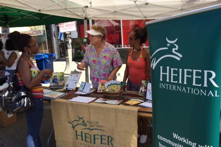 Muellerleile mans a booth as a Heifer volunteer.