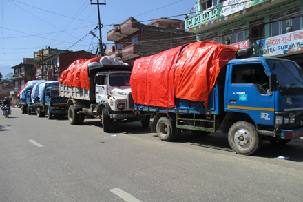 trucks carry relief supplies to families in nepal