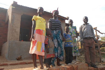 Kelvin Haji with his five children at home in southern Malawi, the area hardest hit by the drought.
