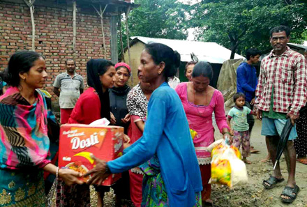 Cooperative members distribute food to flood victims.