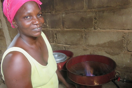 Yacine with the family's new biogas stove.