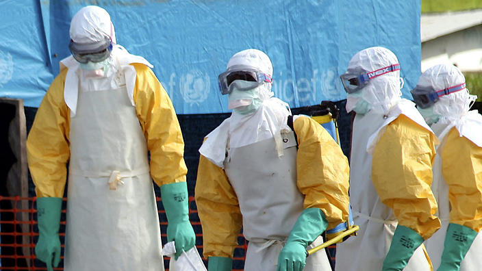 People in hazmat suits prepare to treat those infected with Ebola.