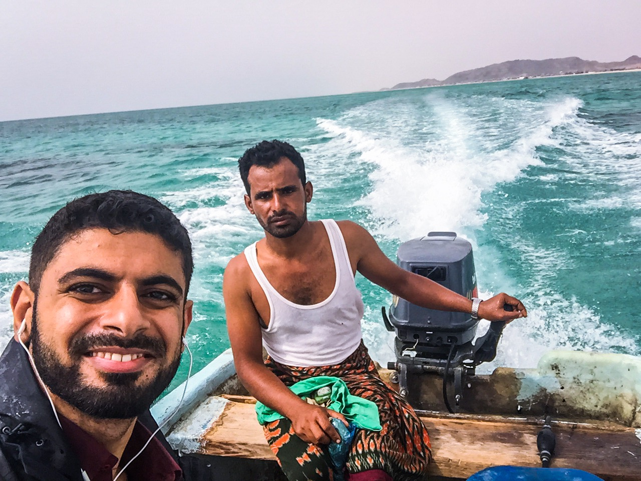 Mokhtar Alkhanshali snapped a selfie with the dubious captain of the skiff one which he escaped.
