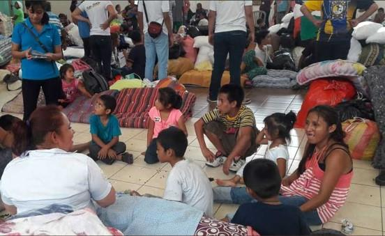 Families gathered in a makeshift shelter.