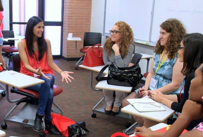Asha Daya mentoring a group of high school girls.