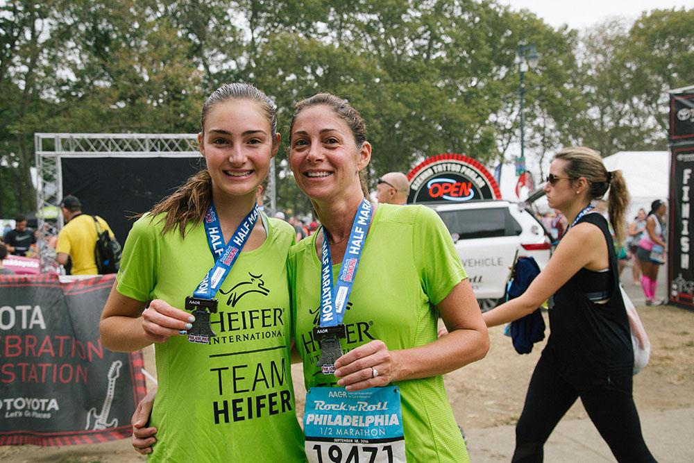 Jane and Carrol Overend show off their half-marathon medals.