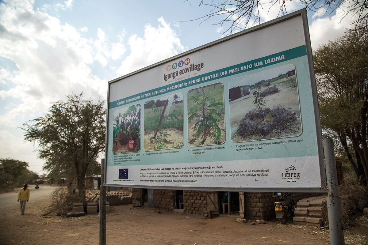 A large sign deptics educational information on agricultural practices.