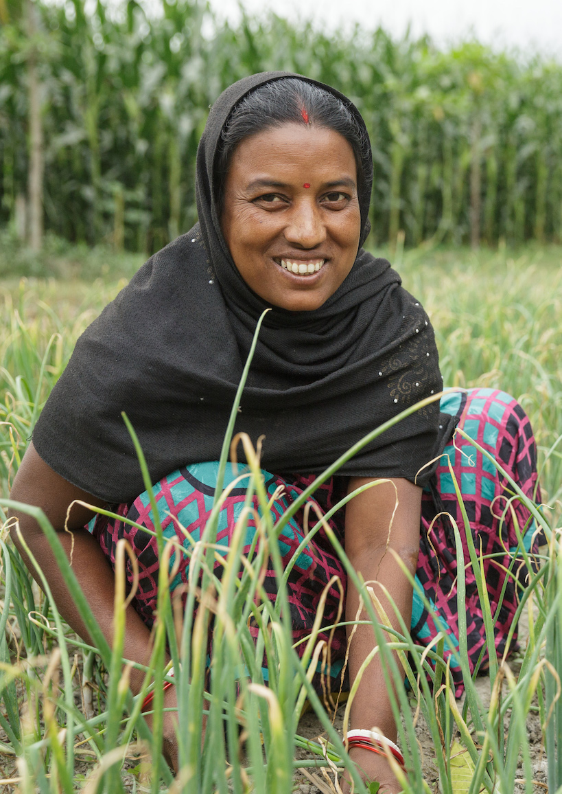 Lakshmi Kisku and her daughter Rashmi work in their onion patch together.