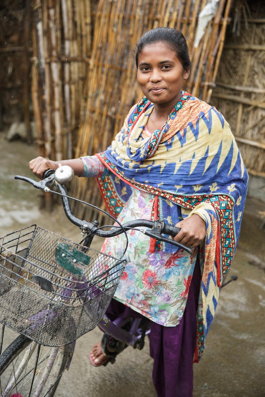 Rashmi Kisku rides her bicycle.