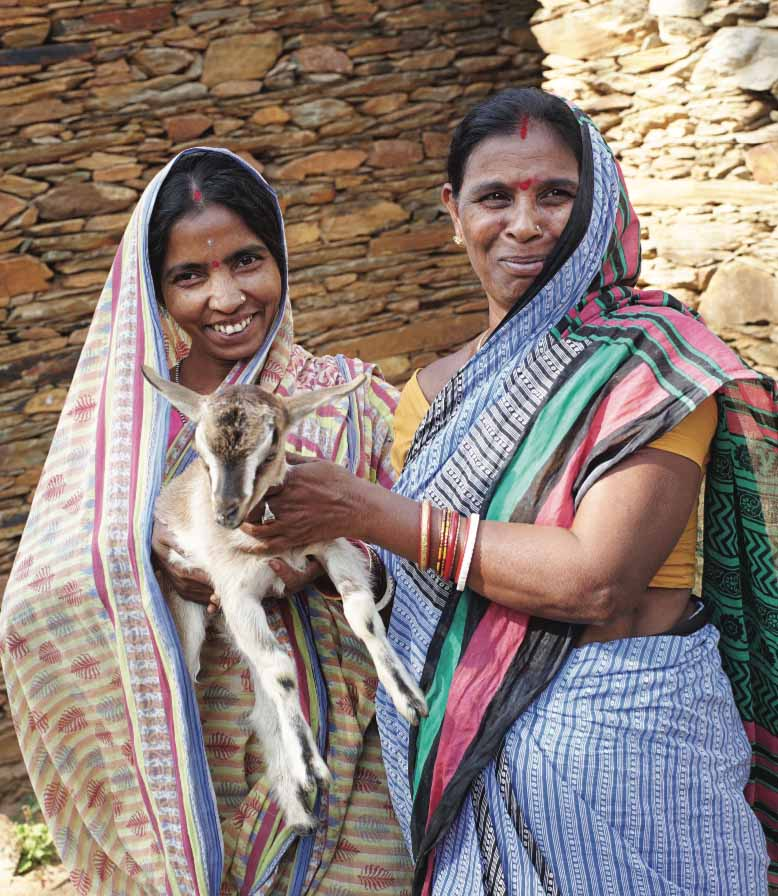 Anusaya Naik (right) decided to share a goat with a neighbor, setting off a chain of giving in Odisha.