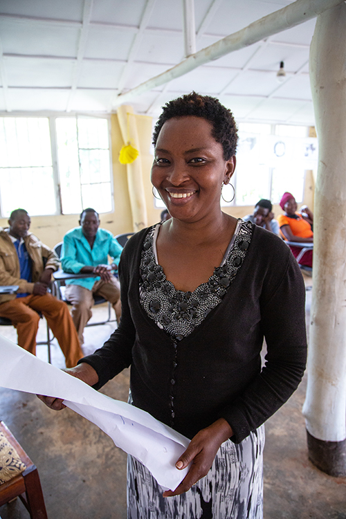 Xaverine Uwimana, the driving force behind Rwanda's EPOG poject, smiles and poses for a photo.