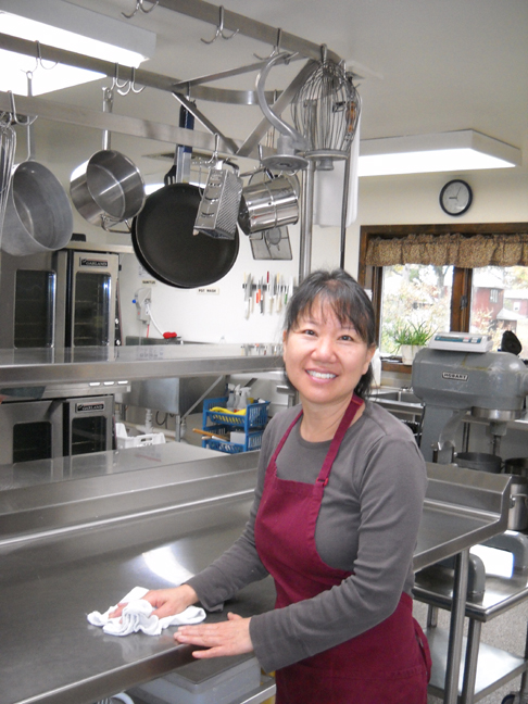 Richard's wife, Jina, volunteering in Kitchen at Heifer Ranch