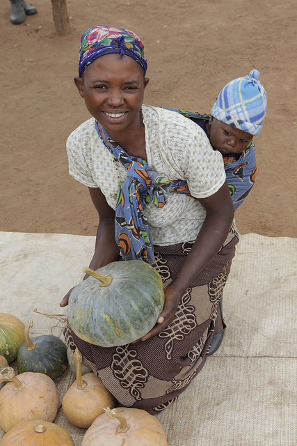 Harriet Shiyanda and her son Joshua Chali show off their pumpkins in the Willie Mulenga village, Zambia. Photo by Russell Powell, courtesy of Heifer International.
