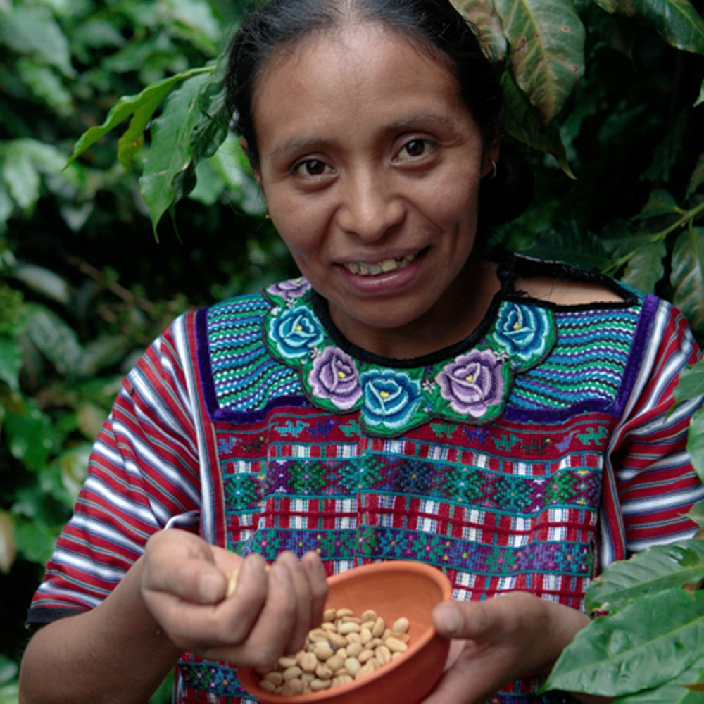 Woman holds coffee beans