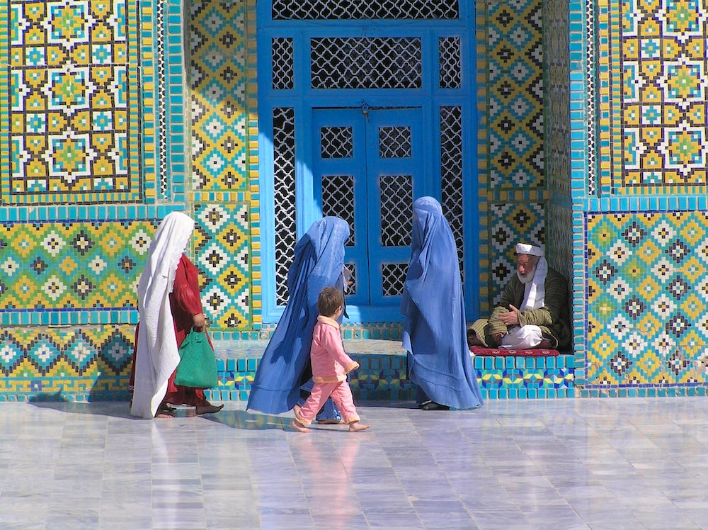 Afghan women wearing burqas at the Blue Mosque in Mazar e Sharif.  In the Taliban time, wearing the burqa was compulsory.  Though no longer officially enforced, many women still observe the tradition (caption and photo by David Sherman).