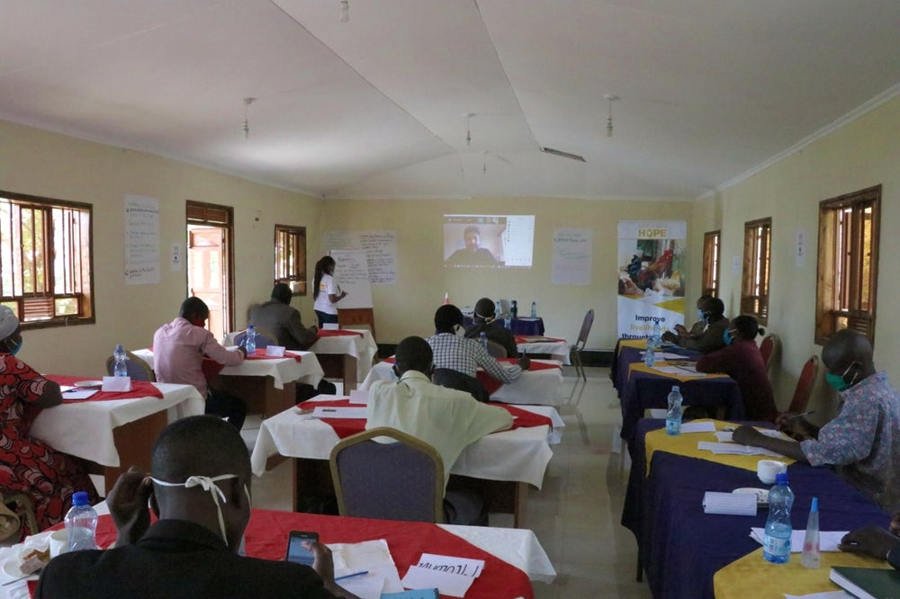 Heifer Kenya community facilitators attend a Corona Warriors training session (while maintaining social distancing and protective measures)