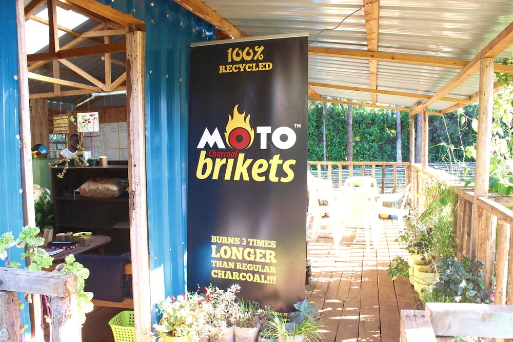 Advertising banner for Moto Brikets, a biofuel product from BrightGreeen Renewable Energy (Nairobi, Kenya), a 2017 D-Lab Scale-Ups Fellowship venture. Photo courtesy MIT D-Lab.
