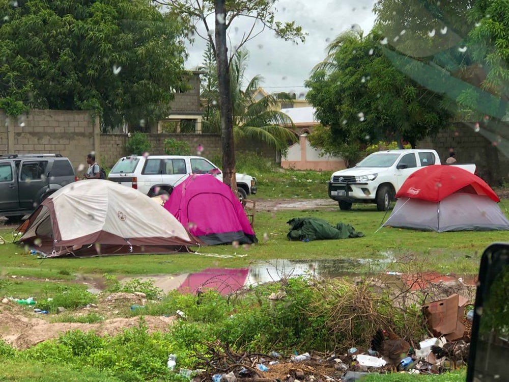 Tents are pitched in Haiti following building's destruction.