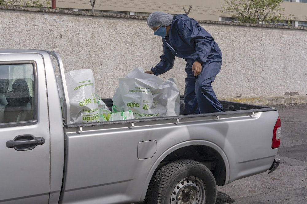 Truck delivering food from Heifer-supported farmers to customers in Quito.