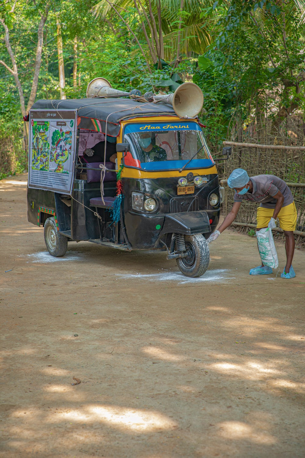 Auto units containing audio systems and educational posters make rounds in villages to generate awareness on COVID-19 precautions and poultry production practices.