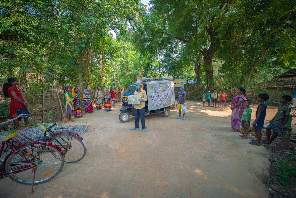 Project staff of Heifer India educating community about biosecurity and safe poultry production practices.