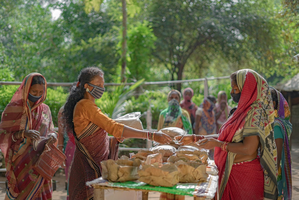 The sale of high quality chicken feed is an additional income that supports entrepreneurs like Lata Marndi. The profits from her feed mill are already paying off.Image by Heifer International/Pranab K. Aich