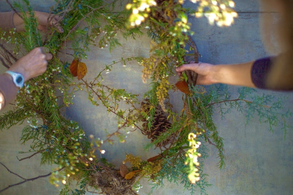 A wreath made from material from a backyard.