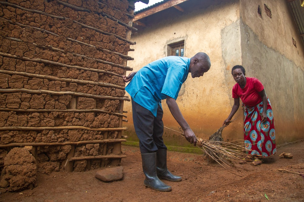 Sibomana helps his wife Beatha with household chores. There was a time when he didn't help out around the house.