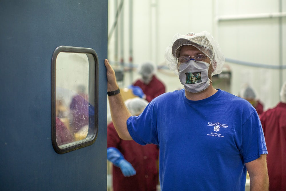 Cody Harper, an employee at The Cypress Valley Meat Company, poses for a photo on the job. Photo by Phillip Davis/Heifer International