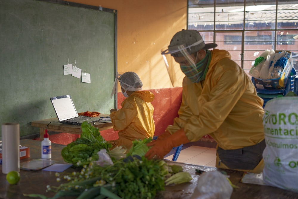 Two workers in prepare food packages in one of the collection centers in Quito, Ecuador.