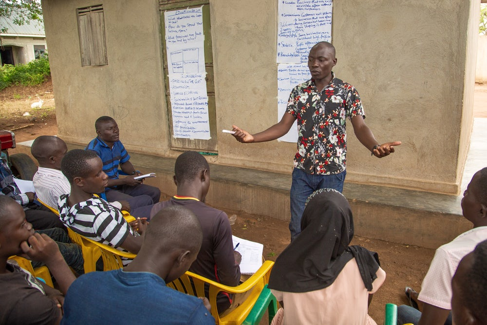 A man directs a class of East Africa Youth Inclusion Project.