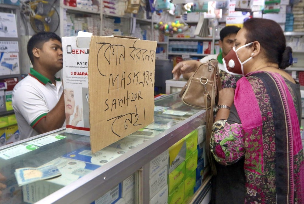 People in India stock up on hand sanitizer and masks to prepare for COVID-19.