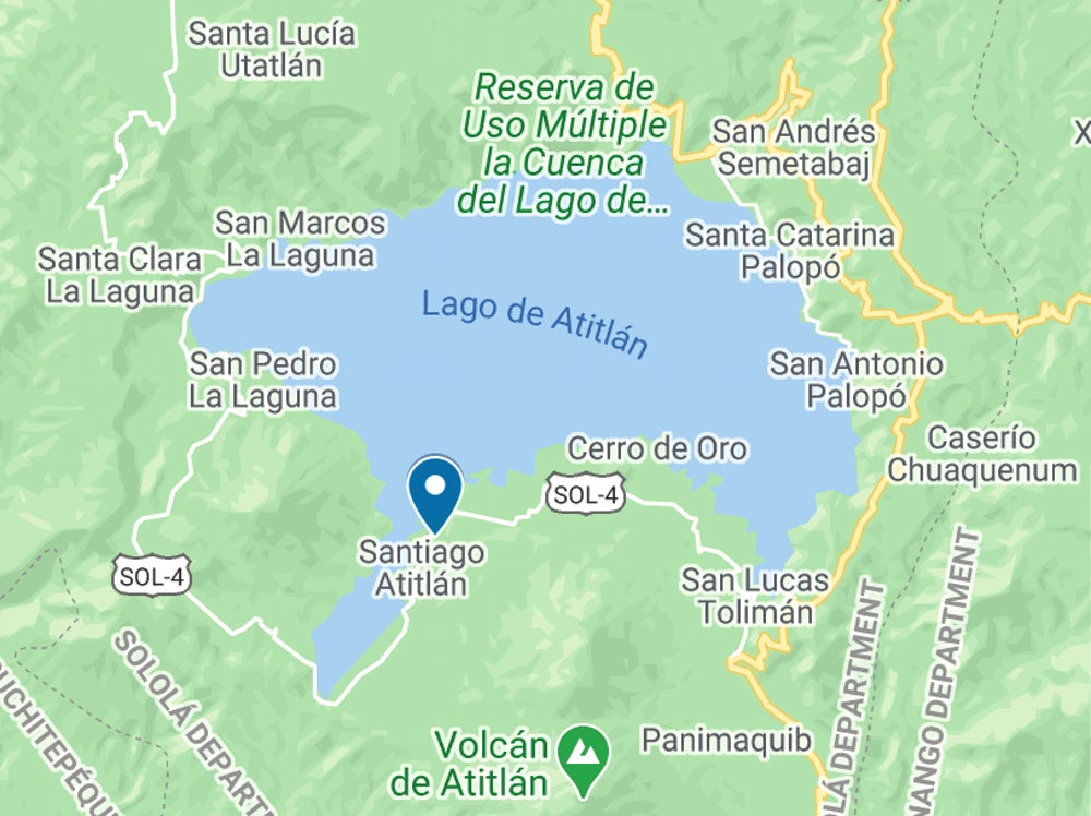 Santiago Atitlán (highlighted by a blue marker) was once the capital city of the Tz'ujil Maya people. Many Tz'ujil and other indigenous peoples still live in Santiago and in other towns around Lake Atitlán. Image courtesy of Google Maps.