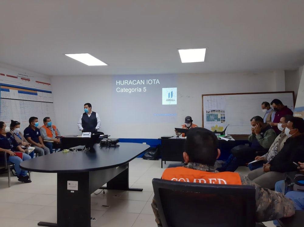 A meeting of COMRED during Hurricane Iota.