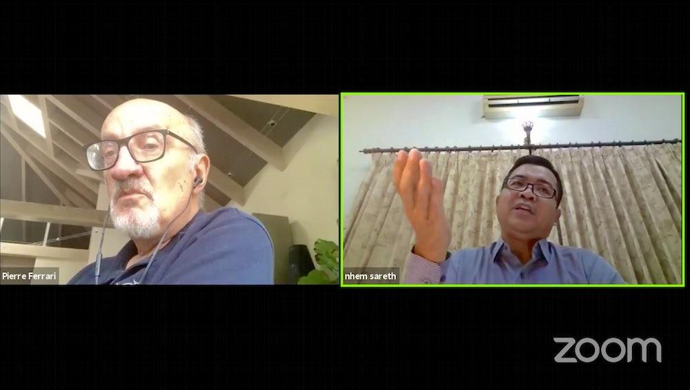 Sareth Nhem, Country Director of Heifer Cambodia, and Pierre Ferarri talk tuk tuks.