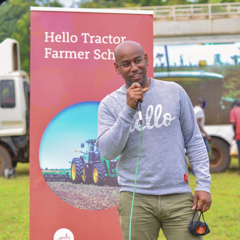 The founder and CEO of Hello Tractor speaks at a microphone.