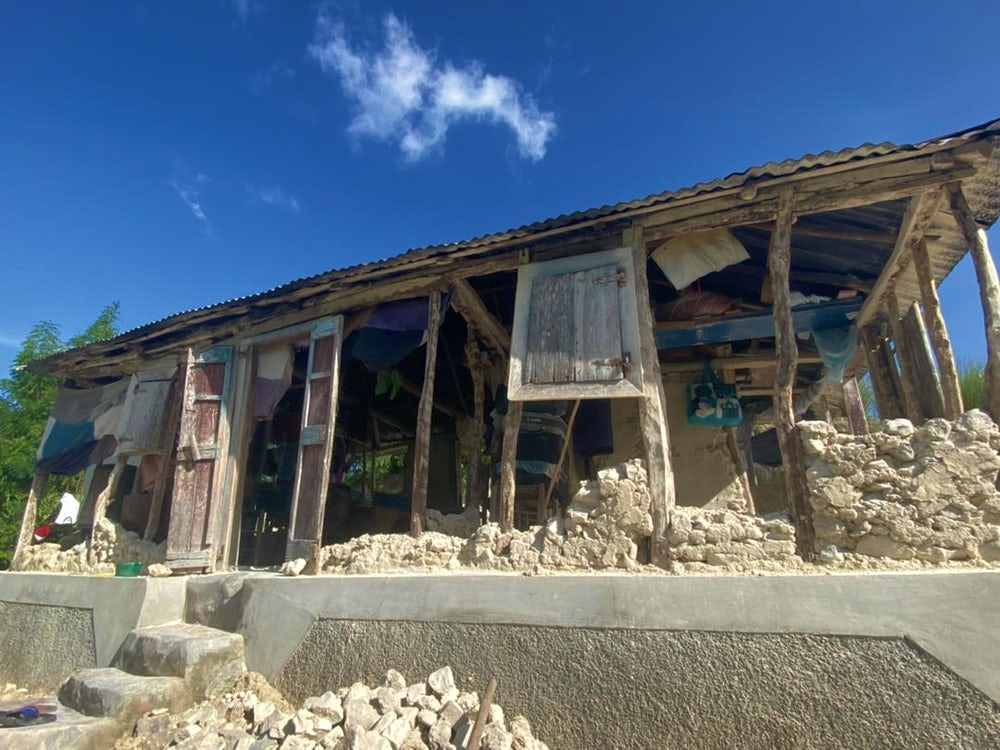 Another house shows extensive damage due to the earthquake.