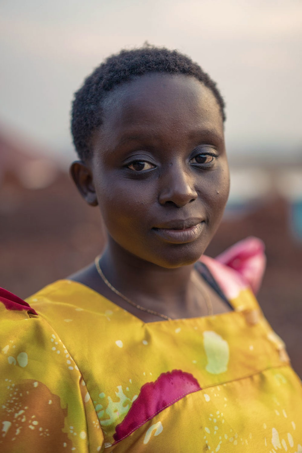 A portrait of a young woman in Uganda.