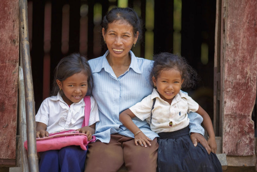Dos Sok, 45, with her nieces Soriya Nang, 4 (right), her sister Nang Seima, 6, in their school uniforms.