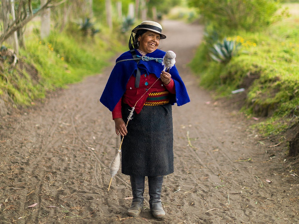 Maria Micaela Castro Sisa, 48, spins wool as she walks down a path in a village near Riobamba, Ecuador.